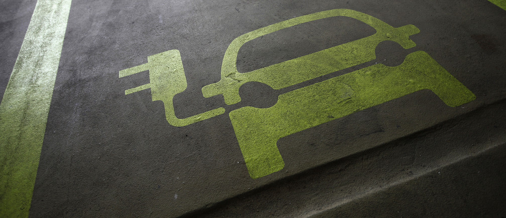 "THIS PICTURE IS 6 OF 25 TO ACCOMPANY INSIGHT ""ELECTRIC-CAR/BIG OIL"". SEARCH IN YOUR PICTURE SYSTEM FOR KEYWORD ""ELECTRIC VEHICLES"" TO SEE ALL IMAGES. (PXP310-334)A sign is painted on a parking space for electric cars inside a car park in Hong Kong January 29, 2012. Many of the headlines out of autoshows in the past couple of years have been captured by the launch of electric cars such as Nissan's Leaf, the Tesla sports car, plug-ins like General Motors' Chevrolet Volt, and the latest incarnation of the Toyota Prius. Other manufacturers including BMW, Rolls Royce and Porsche have presented electric-powered prototypes. On the basis of this, one could be forgiven for thinking the auto industry is betting big on electric power. Yet few auto executives share the optimism of Renault and Nissan chief executive Carlos Ghosn who has repeatedly said he sees electric vehicles making up 10 percent of all sales in 2020. A survey of 200 auto industry executives conducted by KPMG released on Monday gave an average forecast for electric vehicles to account for 6-10 percent of global auto sales in 2025, more bullish than oil companies BP and Exxon who expect electric cars to make up no more than 4-5 percent of all cars globally in 20-30 years. Picture taken January 29, 2012.   To match Insight ELECTRIC-CAR/BIG OIL    REUTERS/Tyrone Siu (CHINA  - Tags: BUSINESS ENERGY ENVIRONMENT SCIENCE TECHNOLOGY) - GM1E8211OVW01"