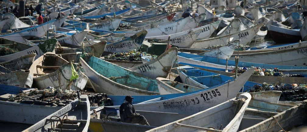 Artisanal fishing boats moored in the harbour at Nouadhibou, Mauritania, April 14, 2018. Picture taken April 14, 2018. To match Special Report OCEANS-TIDE/SARDINELLA    REUTERS/Sylvain Cherkaoui - RC1A74D338F0