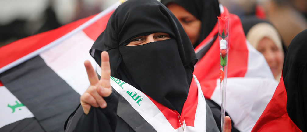 An Iraqi woman celebrates victory over Islamic State in Tahrir Square, Baghdad, Iraq, in December.