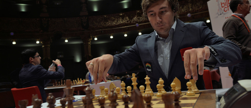 Russian grandmaster Sergey Karjakin adjusts his pieces before a game against Norwegian world chess champion Magnus Carlsen at the IX Chess Masters Final in Bilbao, northern Spain, July 21, 2016. REUTERS/Vincent West  - D1BETQWGAGAB