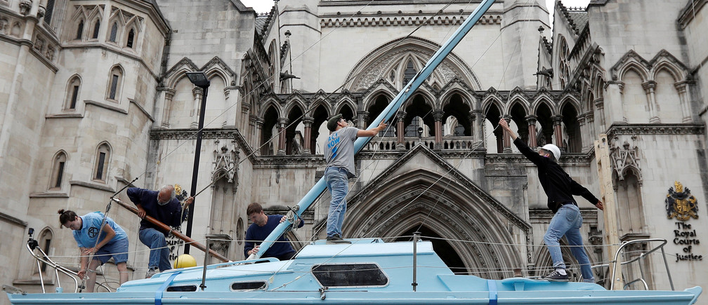 Extinction Rebellion climate activists raise a mast on their boat during a protest outside the Royal Courts of Justice in London, Britain July 15, 2019. REUTERS/Peter Nicholls     TPX IMAGES OF THE DAY - RC120272F000