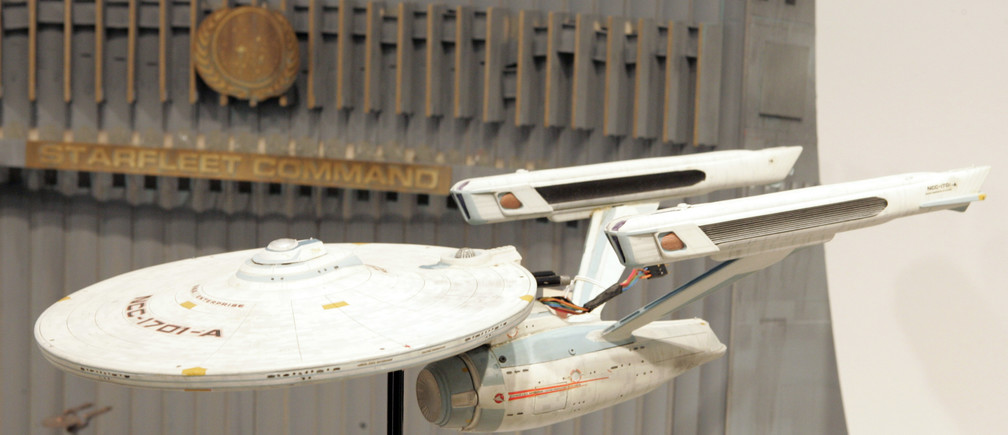 """A replica of the star ship Enterprise sits on display with other props from the television series """"Star Trek"""" during a press preview of the auction  """"40 Years of Star Trek: The Collection"""" at Christie's auction house in New York September 29, 2006. REUTERS/Keith Bedford (UNITED STATES) - GM1DTPLRKXAA"""