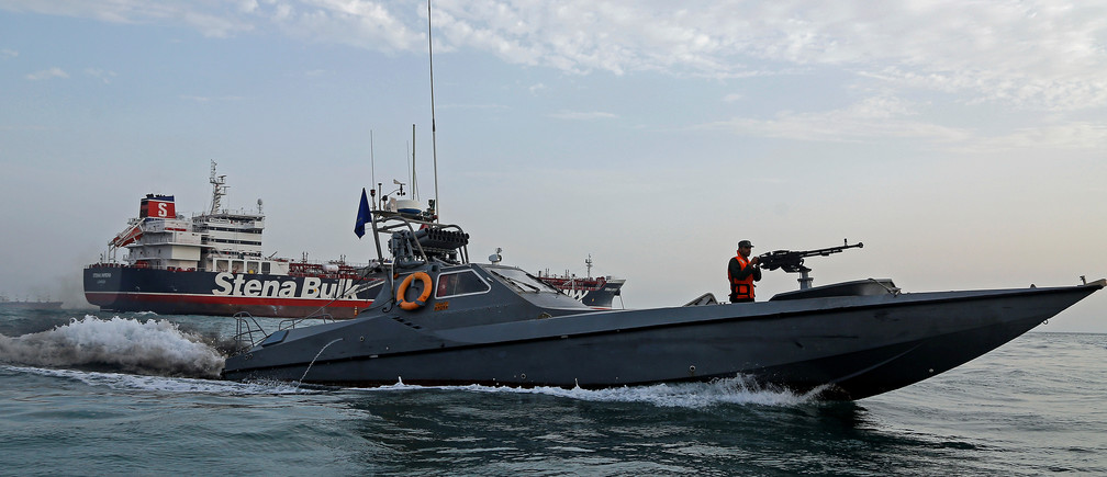 An Iranian Revolutionary Guard boat sails next to the British-flagged Stena Impero in the Strait of Hormuz.