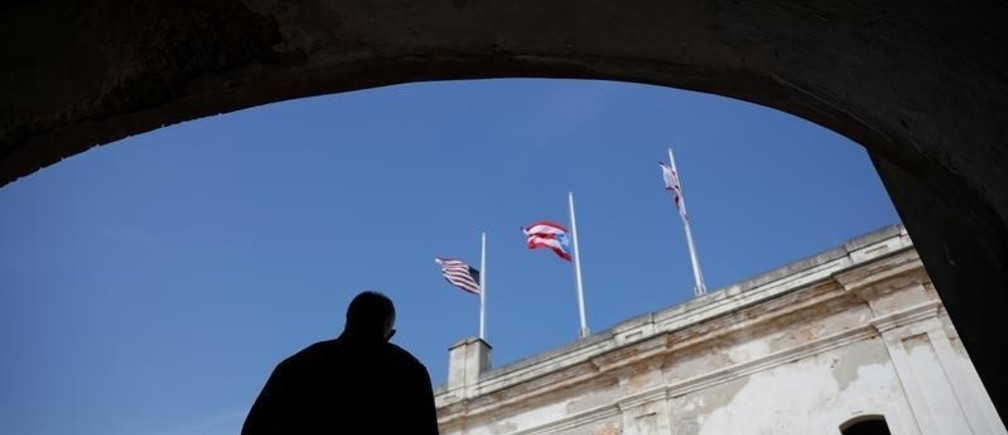 The Puerto Rican and U.S. flags are seen at half mast during a commemorative event organized by the local government a year after Hurricane Maria devastated Puerto Rico, in San Juan, Puerto Rico September 20, 2018.