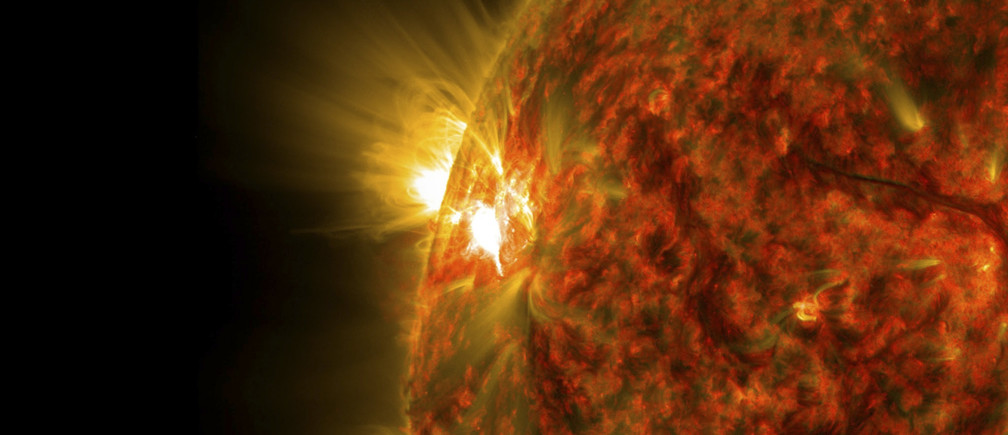 An active region on the sun emitting a mid-level solar flare, peaking at 04:47EST (09:47GMT) is seen in an image was captured by NASA's Solar Dynamics Observatory (SDO) November 5, 2014. This is the second mid-level flare from the same active region, labeled AR 12205, which rotated over the left limb of the sun on November 3.   REUTERS/NASA/SDO/Handout via Reuters  (OUTER SPACE - Tags: SCIENCE TECHNOLOGY) THIS IMAGE HAS BEEN SUPPLIED BY A THIRD PARTY. IT IS DISTRIBUTED, EXACTLY AS RECEIVED BY REUTERS, AS A SERVICE TO CLIENTS. FOR EDITORIAL USE ONLY. NOT FOR SALE FOR MARKETING OR ADVERTISING CAMPAIGNS - RTR4D4QA