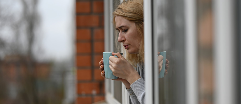 Evgenia Pivovarova drinks tea during self-isolation at home in the southern city of Rostov-on-Don, Russia March 30, 2020. Photographer Sergey Pivovarov and his wife Evgenia were on vacation in Spain when the coronavirus disease (COVID-19) outbreak started. After returning to Russia safely the couple had to spend two weeks self-isolated due to the rules imposed by the authorities. Sergey shares pictures taken inside the family apartment during this time. Picture taken March 30, 2020. REUTERS/Sergey Pivovarov - RC2KWF9G7RBU