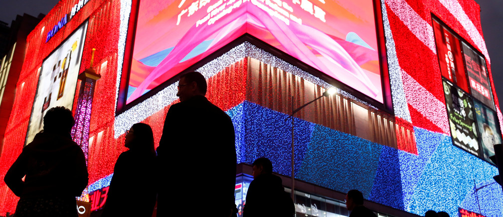 People walk in Huaqiangbei Commercial Street, a shopping district for electronics and market place for Chinese producers and international wholesale buyers, in Shenzhen, Guangdong Province, China, December 13, 2018.  Picture taken December 13, 2018.  REUTERS/Thomas Peter - RC1BD6801EB0