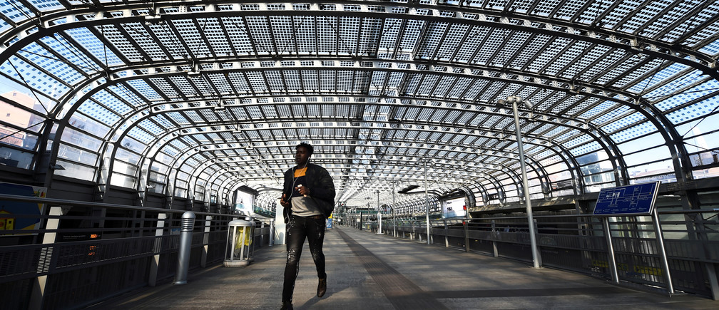A person walks at Torino Porta Susa railway station, after a decree orders for the whole of Italy to be on lockdown in an unprecedented clampdown aimed at beating the coronavirus, in Turin, Italy, March 10, 2020. REUTERS/Massimo Pinca - RC23HF9M0PN9