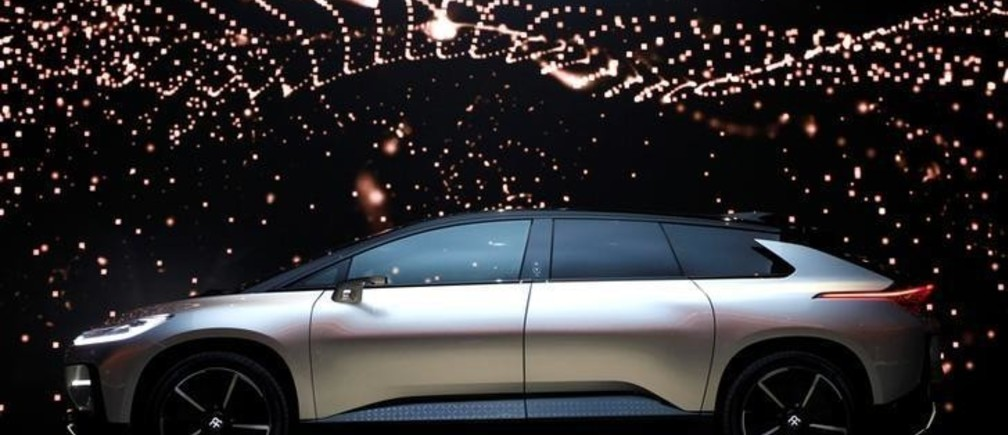 A Faraday Future FF 91 electric car is displayed on stage during an unveiling event at CES in Las Vegas, Nevada January 3, 2017. REUTERS/Steve Marcus     TPX IMAGES OF THE DAY