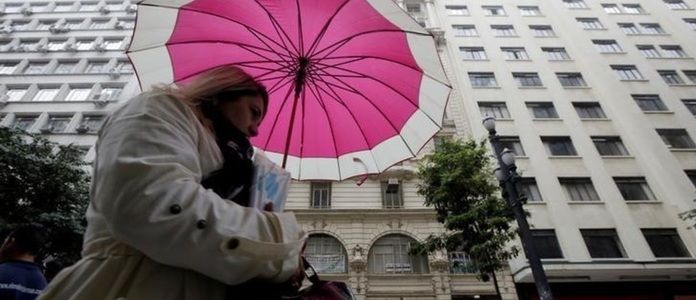 A woman walks on the street during the first day of the winter season in downtown Sao Paulo, Brazil June 21, 2017. REUTERS/Paulo Whitaker