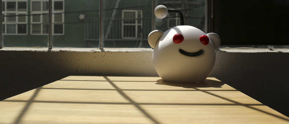 A Reddit mascot is shown at the company's headquarters in San Francisco, California April 15, 2014. Reddit, a website with a retro-'90s look and space-alien mascot that tracks everything from online news to celebrity Q&As, is going after more eyeballs, and advertising, by allowing members of its passionate community to post their own news more quickly and easily. REUTERS/Robert Galbraith  (UNITED STATES - Tags: BUSINESS SCIENCE TECHNOLOGY) - GM1EA4G0IMO01