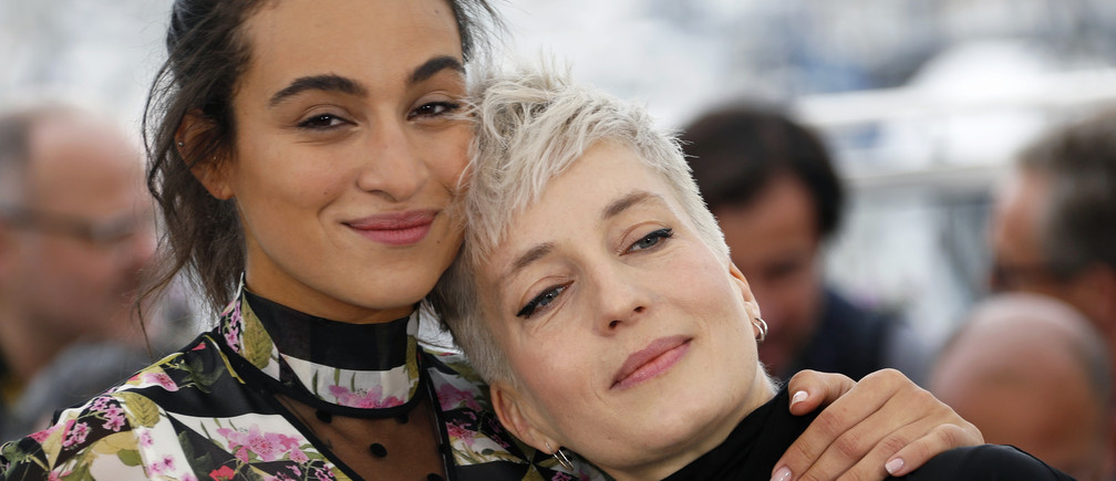 """72nd Cannes Film Festival - Photocall for the film """"Haut les filles"""" as part of beach cinema screening - Cannes, France, May 21, 2019. Cast members Camelia Jordana and Jeanne Added pose. REUTERS/Eric Gaillard"""