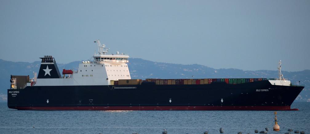 A cargo ship is seen anchored, as Italy struggles to contain the spread of coronavirus disease (COVID-19), in Naples, Italy March 29, 2020. REUTERS/Ciro De Luca - RC2VTF9LTJME