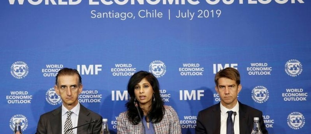 Gita Gopinath, Economic Counsellor and Director of the Research Department at the International Monetary Fund (IMF), next to Gian Maria Milesi-Ferretti, Deputy Director of Research Department of the IMF, speaks during a news conference in Santiago, Chile,  July 23, 2019. REUTERS/Rodrigo Garrido - RC187BEC77C0