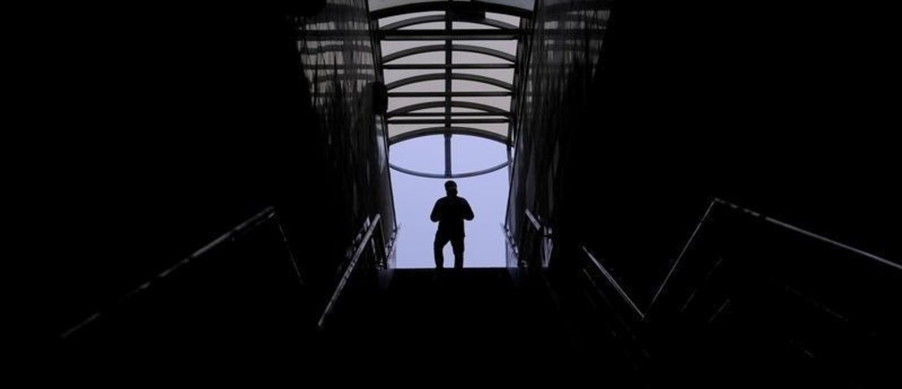 A man walks along a staircase in a pedestrian tunnel in Moscow, Russia November 8, 2019. REUTERS/Evgenia Novozhenina - RC247D9URANO