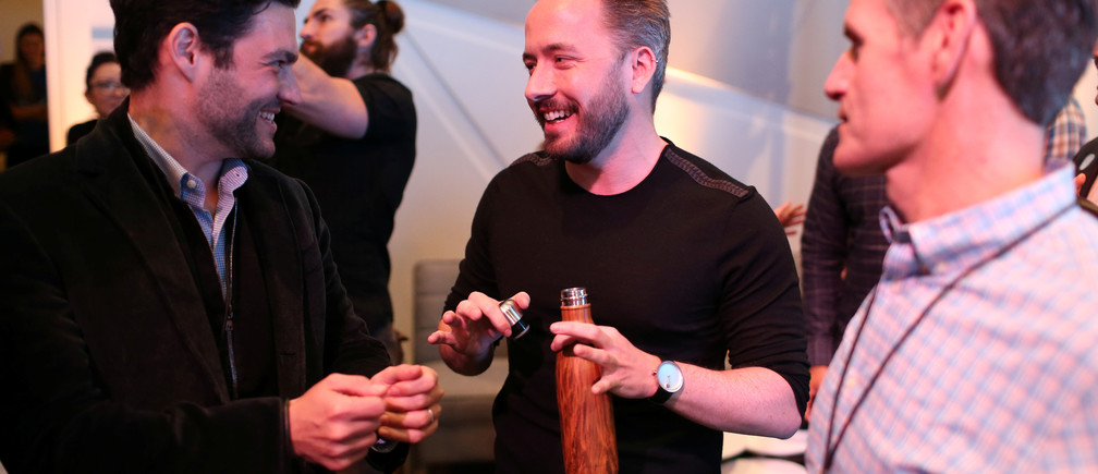 Drew Houston (2nd L), Chief Executive Officer and founder of Dropbox, converses following the cloud storage company's announcement event in San Francisco, California, U.S., January 30, 2017.  REUTERS/Beck Diefenbach - RTX2YW3V