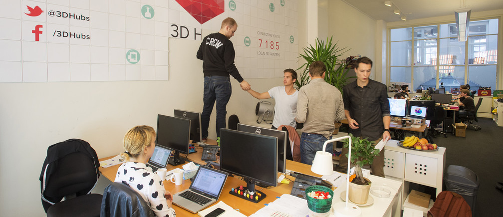 Workers are seen at the 3D Hubs office in Amsterdam September 2, 2014. In a continent where one in five young people are out of work, governments are pumping more and more cash into startups in the hope they can goose economic growth. Exact numbers are hard to determine, but according to AngelList, a website for new companies, there are now more than 4,700 startups in Europe, compared with nearly 14,000 in the United States. Picture taken September 2, 2014. To match Insight EUROPE-STARTUPS/MAKERS        REUTERS/Toussaint Kluiters/United Photos    (NETHERLANDS  - Tags: BUSINESS SCIENCE TECHNOLOGY) - RTR4690V