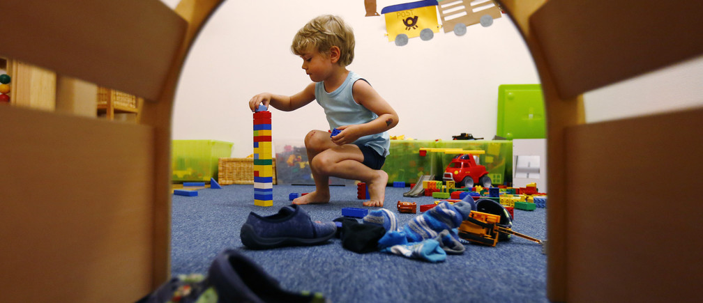 A four year-old boy plays at a nursery.