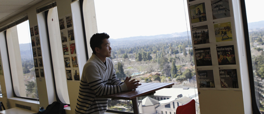 "Tim Chae gazes out a window where he attends ""500 Startups,"" a crash course for young companies run by a funding firm of the same name, in Mountain View February 16, 2012."