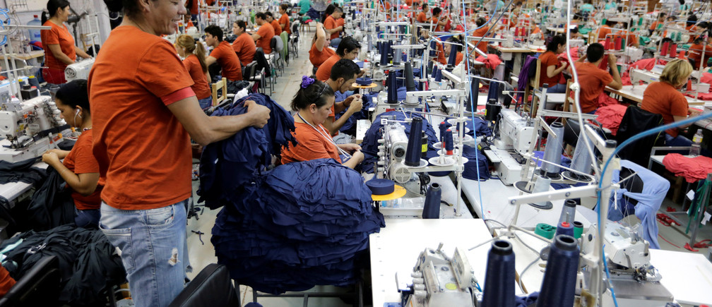 Paraguayan workers assemble clothes for Brazilian retailer Riachuelo at the factory of Texcin in Limpio, Paraguay December 20, 2016.
