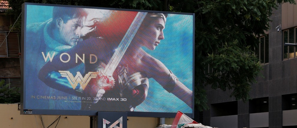 "An advertisement of ""Wonder Woman"" movie is pictured near an army post in Beirut, Lebanon May 31, 2017. REUTERS/Mohamed Azakir - RC1F1FC2B200"