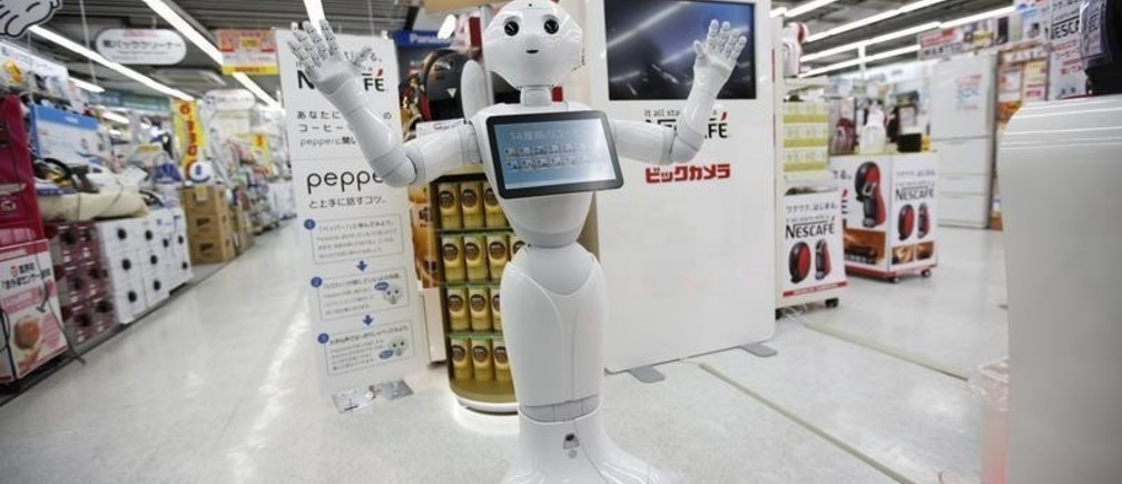 "SoftBank Corp's human-like robot named ""Pepper"" gestures as it introduces Nestle's coffee machines at an electric shop in Tokyo December 1, 2014. Nestle SA started to use robots to help sell its coffee makers at electronics stores across Japan, becoming the first corporate customer for the chatty, bug-eyed androids unveiled in June by tech conglomerate SoftBank Corp. The waist-high robot, developed by a French company and manufactured in Taiwan, was touted by Japan's SoftBank as capable of learning and expressing human emotions, and of serving as a companion or guide in a country that faces chronic labour shortages. The maker of Nescafe coffee and KitKat chocolate bars plans to have the robots working at 1,000 stores by the end of next year, a Nestle official said. REUTERS/Issei Kato (JAPAN - Tags: SCIENCE TECHNOLOGY SOCIETY BUSINESS TPX IMAGES OF THE DAY) - GM1EAC111WO01"