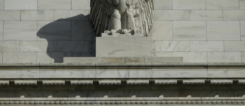 A detail from the front of the United States Federal Reserve Board building is shown in Washington October 28, 2014. The U.S. Federal Reserve this week will likely reinforce its stated willingness to wait a long while before hiking interest rates after a volatile month in financial markets that saw some measure of inflation expectations drop worryingly low.   REUTERS/Gary Cameron  (UNITED STATES - Tags: BUSINESS POLITICS) - RTR4BX51