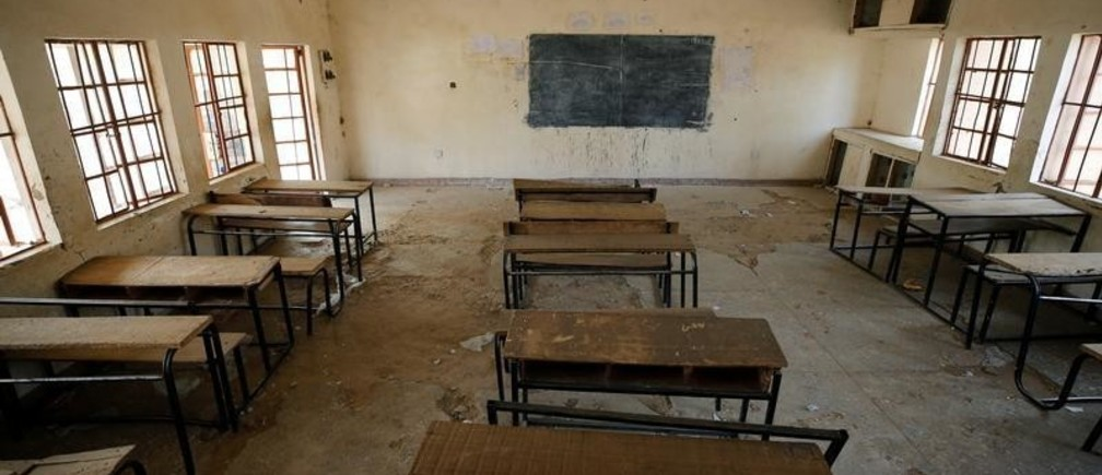 A view shows an empty classroom at the school in Dapchi in the northeastern state of Yobe, where dozens of school girls went missing after an attack on the village by Boko Haram, Nigeria February 23, 2018. REUTERS/Afolabi Sotunde - RC1642E65E00
