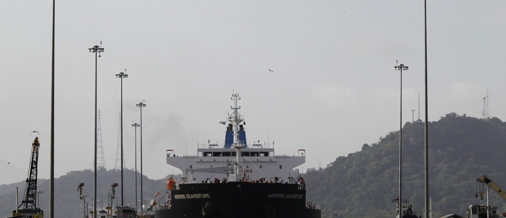 A cargo ship at the Miraflores locks in Panama City December 31, 2014. Panama canal celebrates 15th years from when the U.S gave control of the canal to Panama. Officially, on 31st December 1999, the Panama Canal became the possession of the nation of Panama, ending nearly a century of American jurisdiction over one of the world's most strategic waterways. REUTERS/Carlos Jasso (PANAMA - Tags: SOCIETY MARITIME BUSINESS ANNIVERSARY) - RTR4JRYY
