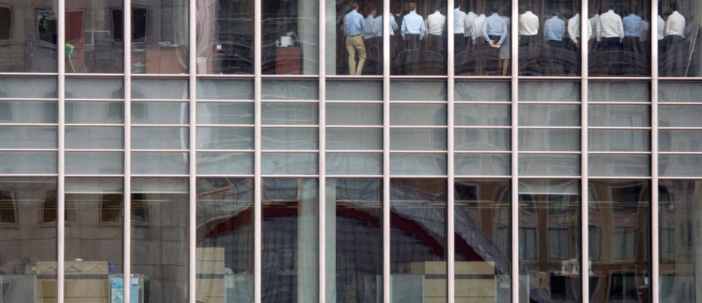 "Bankers attend an emergency meeting at the London office of Lehman Brothers, in the financial district of Canary Wharf in London, Britain, September 11, 2008. The photograph caught the moment when Gwion Moore, one of those pictured in the photograph, and his colleagues were being told by bosses that things were going to be OK, despite the plummeting Lehman Brothers share price. ""Senior management thought they needed to get the workforce focused again,"" Moore said. ""The phrase was stop 'goofing around and get back to work'. I don't think anyone took the message very seriously because we went back to doing what we had been doing beforehand. No one was going to trade with us."" REUTERS/Kevin Coombs/File photo     SEARCH ""LEHMAN 10"" FOR THIS STORY. SEARCH ""WIDER IMAGE"" FOR ALL STORIES.  TPX IMAGES OF THE DAY. - RC163BD644D0"