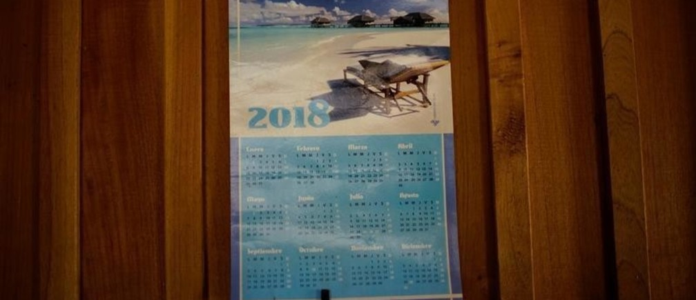 A calendar hangs on the wall of a house in the mountains near Santo Domingo, Cuba, March 31, 2018. Picture taken March 31, 2018. REUTERS/Alexandre Meneghini - RC112C9421B0
