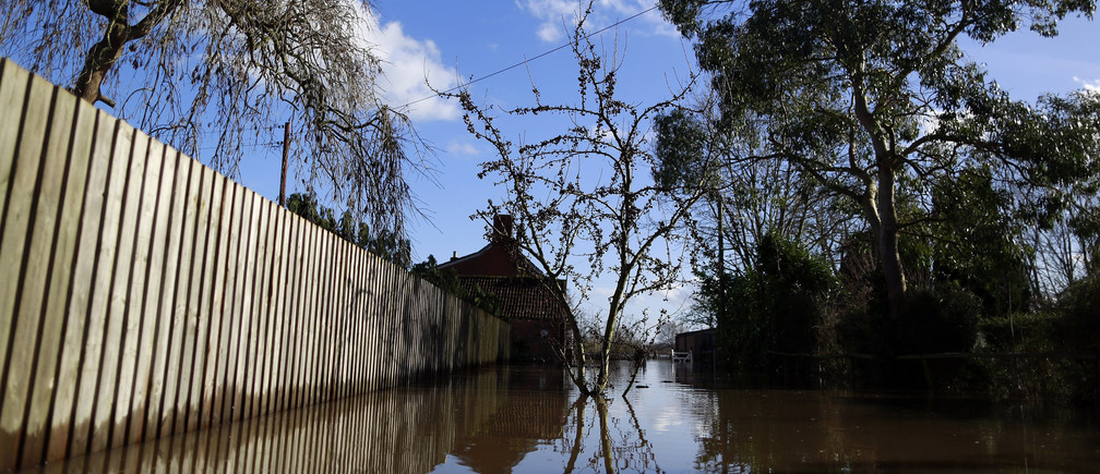 Blue skies are seen over urban landscape taken in the flooded Somerset village of Moorland February 16, 2014.