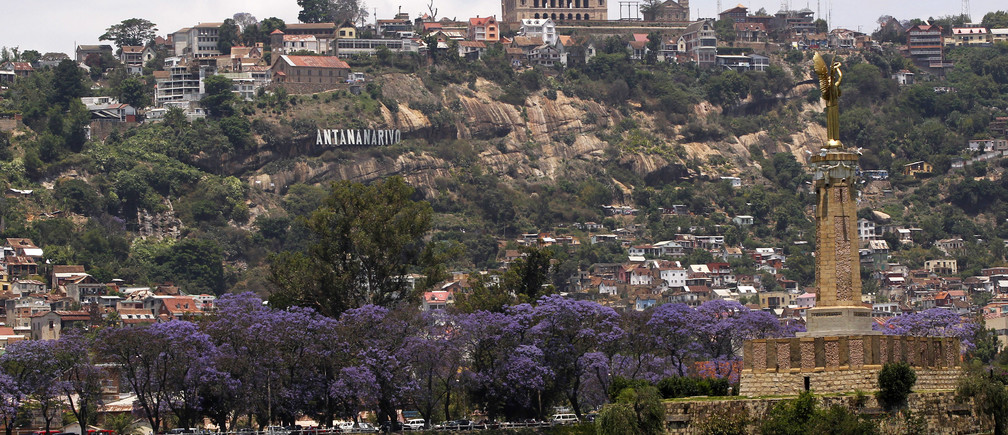 """A general view shows the cityscape and the Queen Palace, also called Manjakamiadana, in Madagascar's capital Antananarivo, October 24, 2013. Voters in Madagascar's presidential election on Friday desperately hope for an end to a five-year political crisis that has scared off investors and severely damaged the economy, but there is little optimism they will get their wish. There are low expectations on the nickel and vanilla-producing Indian Ocean island for a conclusive result from the first vote since 39-year-old former disc jockey Andry Rajoelina seized power in a military-backed coup in March 2009.  Antananarivo means """"the city of a thousand"""", to refer to the 1000 soldiers that hypothetically guarded the newly found city during the supremacy of the revered King Andrianjaka. REUTERS/Thomas Mukoya (MADAGASCAR - Tags: POLITICS ELECTIONS CITYSCAPE) - GM1E9AO1K8K01"""