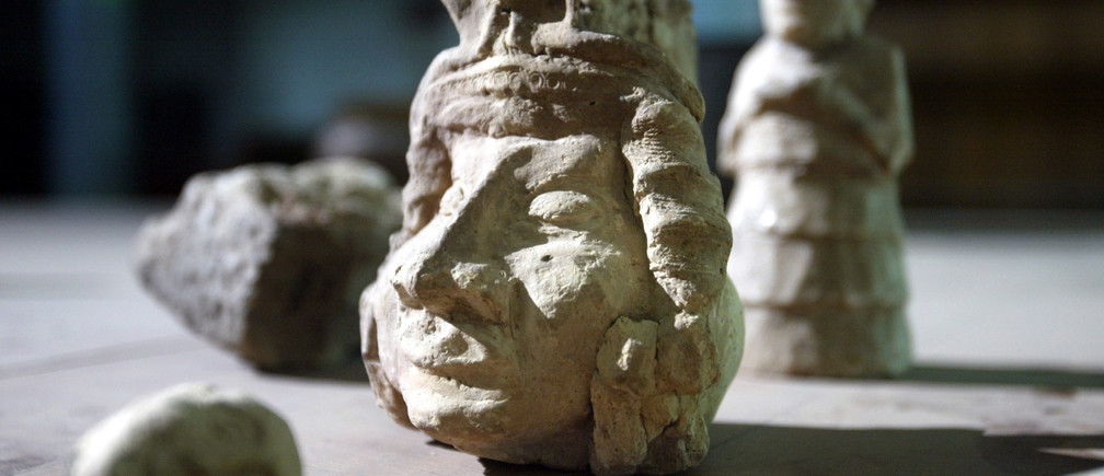 "Recently recovered artifacts are accounted for at the "" Iraq Museum"" in Baghdad, May 4, 2003. Museum staff have confirmed 27 pieces are still missing after looters entered the premises in the early hours after the fall of Baghdad. The museum's collection included Sumerian, Akkadian, Babylonian, Assyrian, Chaldean and Abbasid artifacts. - PBEAHUOPWCS"