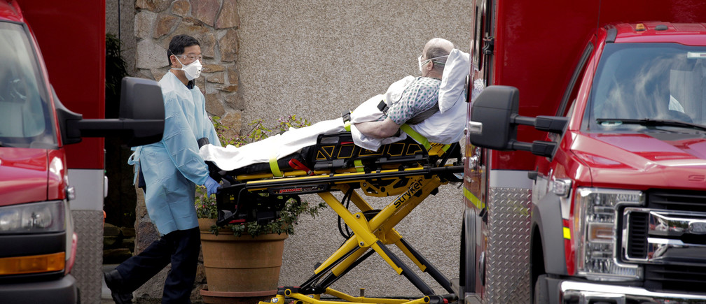 Medics transport a man on a stretcher into an ambulance at the Life Care Center of Kirkland, a long-term care facility linked to several confirmed coronavirus cases, in Kirkland, Washington, U.S. March 3, 2020.  REUTERS/David Ryder     TPX IMAGES OF THE DAY - RC2MCF9808CI