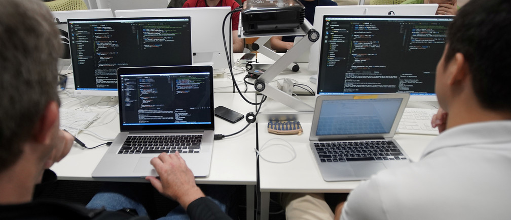 Students attend Code Chrysalis, a software-coding boot camp, at a basement room in Tokyo, Japan, May 23 2018. Picture taken May 23 2018. REUTERS/Toru Hanai - RC1F42DD5780