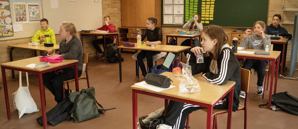 Pupils are seen during lunch break at the Korshoejskolen school, after it reopened following the lockdown due to the coronavirus disease (COVID-19) spread, in Randers, Denmark, April 15, 2020.