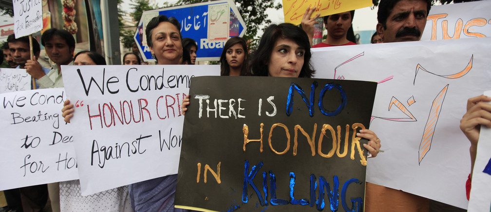 Members of civil society and the Human Rights Commission of Pakistan hold placards during a protest in Islamabad