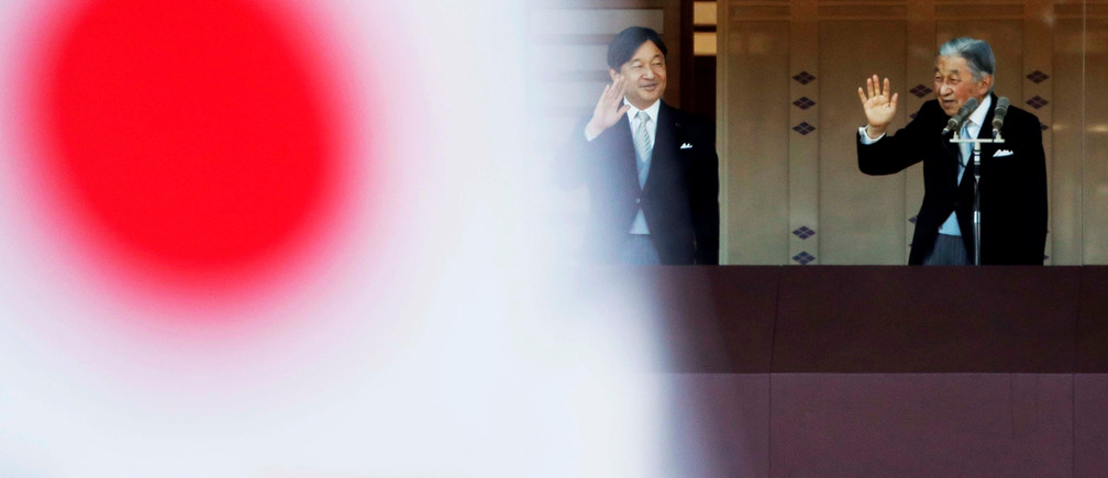 Japan's Emperor Akihito and Crown Prince Naruhito are seen behind Japanese national flags as they waves to well-wishers during a public appearance for New Year celebrations at the Imperial Palace in Tokyo, Japan, January 2, 2019.   REUTERS/Issei Kato - RC19957F4B40