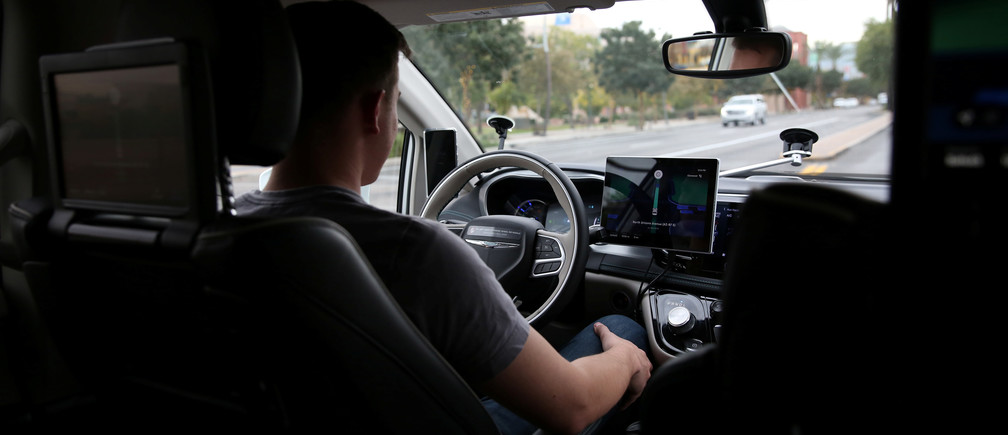 Waymo Trained Driver Derek Sirakis looks forward as the car drives during a demonstration in Chandler, Arizona, November 29, 2018. Picture taken November 29, 2018