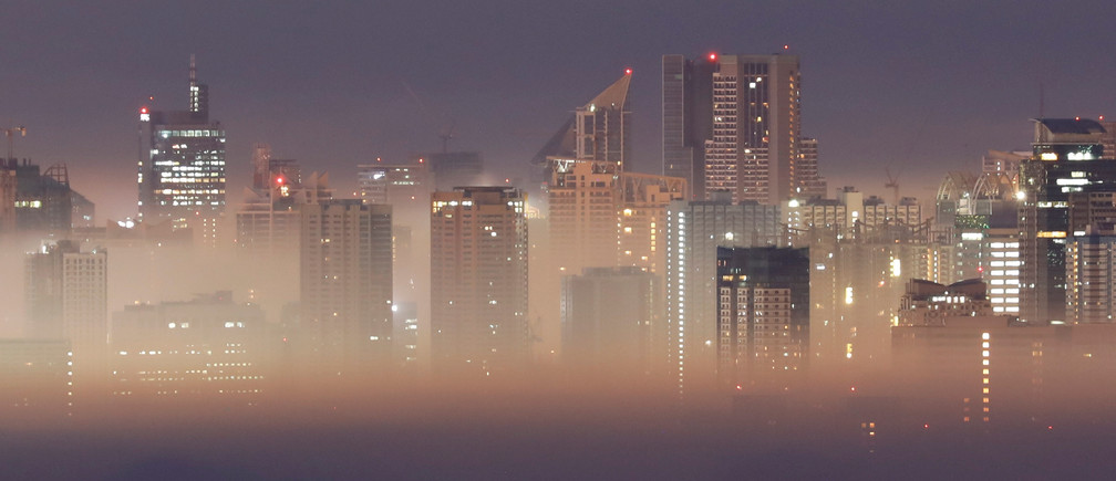 The Metro Manila skyline is seen during smog on the first break of dawn of the New Year in Antipolo City, Rizal province, Philippines, January 1, 2019
