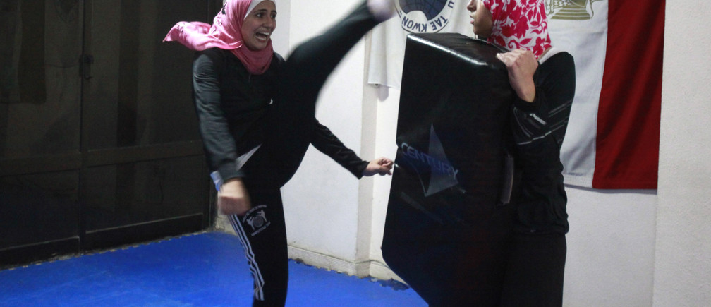 Women train as they take part in a self-defence class at a studio in Cairo January 9, 2012. Some of the female participants said they took up the class to protect themselves due to the instability in the country since the ouster of Hosni Mubarak. There were about 20 students during the training session, with almost twice as many women as men. REUTERS/Asmaa Waguih