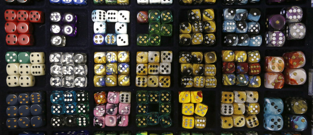 Sets of dice are seen on display during a board games festival in St. Petersburg, April 20, 2014. The festival was organised by vendors of board games to encourage young people to use and buy their products.   REUTERS/Alexander Demianchuk (RUSSIA - Tags: BUSINESS SOCIETY) - GM1EA4L00ZS01