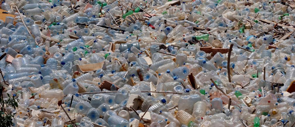 Empty plastic bottles are photographed nearby the public beach in Khaldeh, near Beirut, Lebanon June 6, 2017. REUTERS/Mohamed Azakir - RTX399ZV