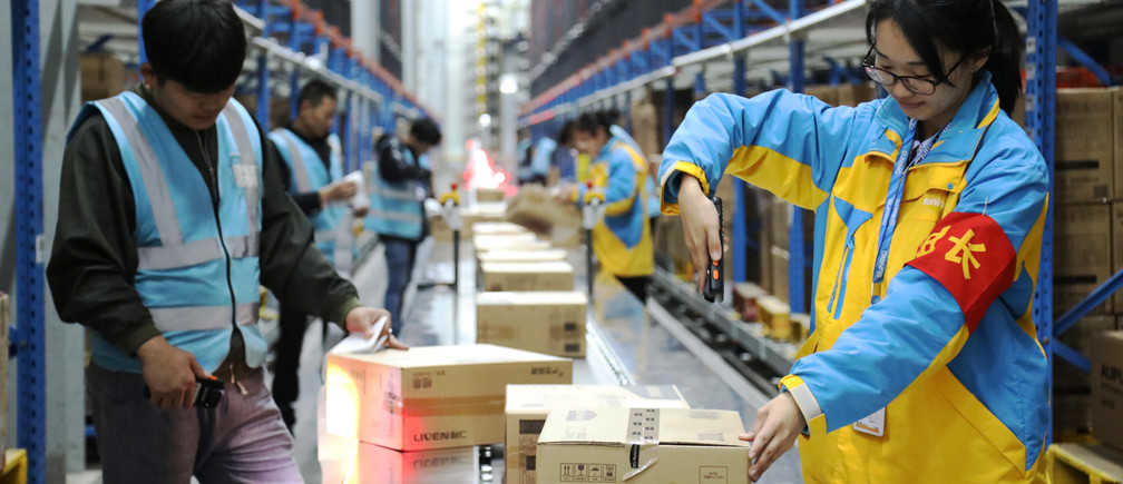 Employees scan parcels at a Suning logistics base in Nanjing, China, ahead of the Singles' Day shopping festival