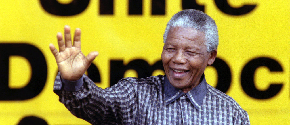 South African President Nelson Mandela greets supporters during a celebration of the 84th birthday of his ruling African National Congress (ANC) January 8. Mandela said although South Africans had enjoyed political freedom for two years, it would take decades to redress racial inequalities caused by apartheid - PBEAHUMSBDA