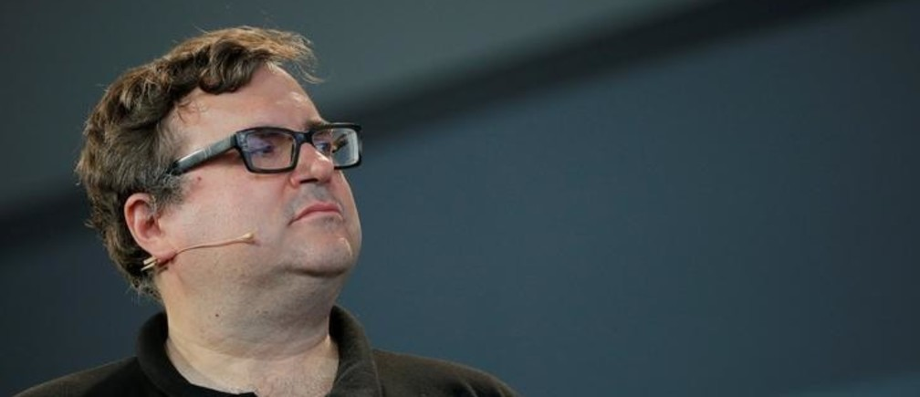 """Reid Hoffman, co-founder of LinkedIn, listens after presenting the inaugural Disobedience Award, which he funded, during """"Defiance!"""" at Massachusetts Institute of Technology (MIT) in Cambridge, Massachusetts, U.S., July 21, 2017.   REUTERS/Brian Snyder"""