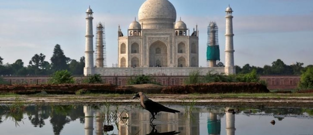 The Taj Mahal is reflected in a puddle in Agra, India August 9, 2016. REUTERS/Cathal McNaughton