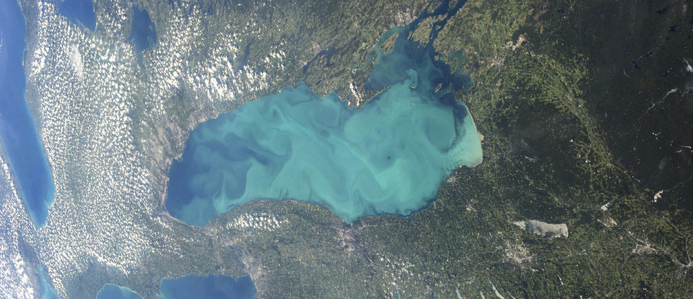 Late summer plankton blooms across much of Lake Ontario, one of North America's Great Lakes, in this photograph taken by an astronaut on the International Space Station courtesy of NASA. Microscopic cyanobacteria, or blue-green algae, can reach such large concentrations and color the water to such an extent that the change is visible from orbit.  REUTERS/NASA/Handout  (CANADA - Tags: SCIENCE TECHNOLOGY ENVIRONMENT) THIS IMAGE HAS BEEN SUPPLIED BY A THIRD PARTY. IT IS DISTRIBUTED, EXACTLY AS RECEIVED BY REUTERS, AS A SERVICE TO CLIENTS. FOR EDITORIAL USE ONLY. NOT FOR SALE FOR MARKETING OR ADVERTISING CAMPAIGNS - GM1E98V0C7802