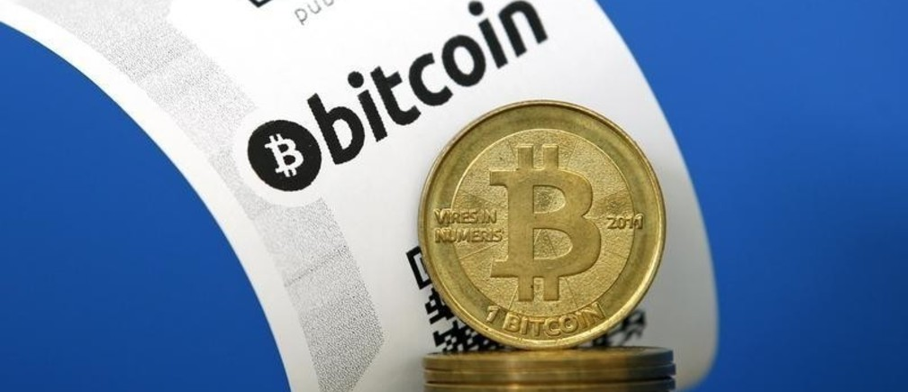 A Bitcoin (virtual currency) paper wallet with QR codes and coins are seen in an illustration picture taken at La Maison du Bitcoin in Paris July 11, 2014. French police dismantled an illegal Bitcoin exchange and seized 388 virtual currency units worth some 200,000 euros ($272,800) in the first such operation in Europe a public prosecutor said on Monday.   REUTERS/Benoit Tessier (FRANCE - Tags: BUSINESS) - PM1EA7B1GZZ01